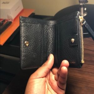 Wallet with a coin zipper